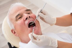 Close-up Of A Senior Man Undergoing Dental Treatment In Clinic